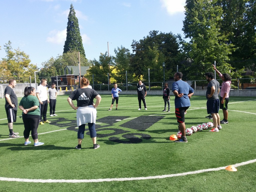 Our coaches circle up for a practice demonstration.